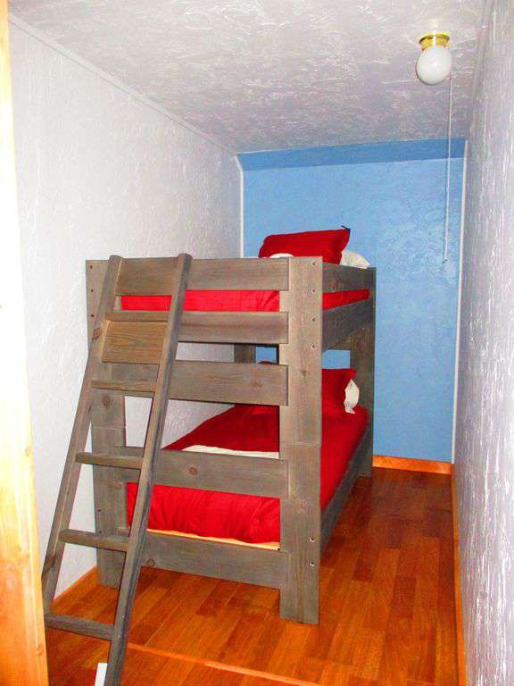 Cubby hole with twin bunk beds and barn doors
