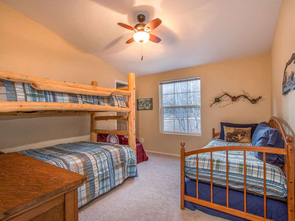 Main house bedroom 1 - twin over double bunk, twin with trundle bed under.