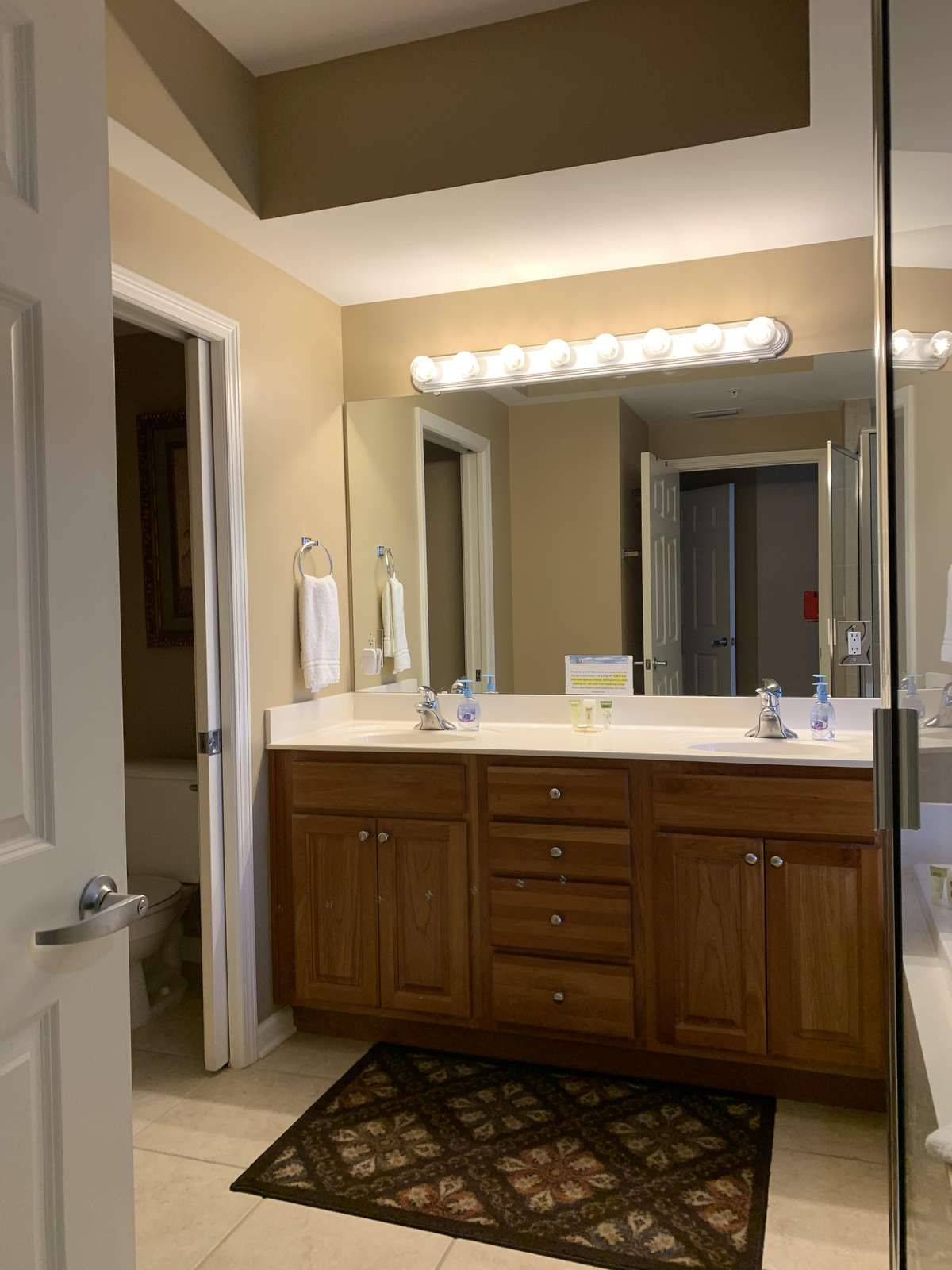 Master bathroom with double sinks and water closet