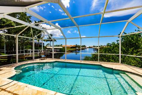 Stunning water view. Heated pool. Gulf access canal. Villa Quebec