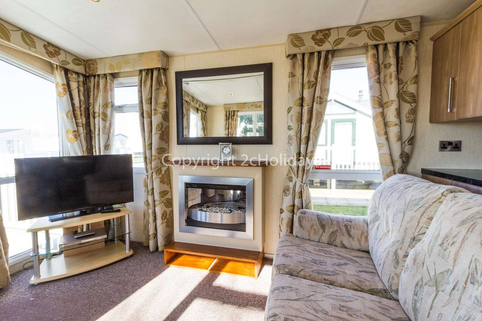 This lounge includes a double sofa bed and gas fire!