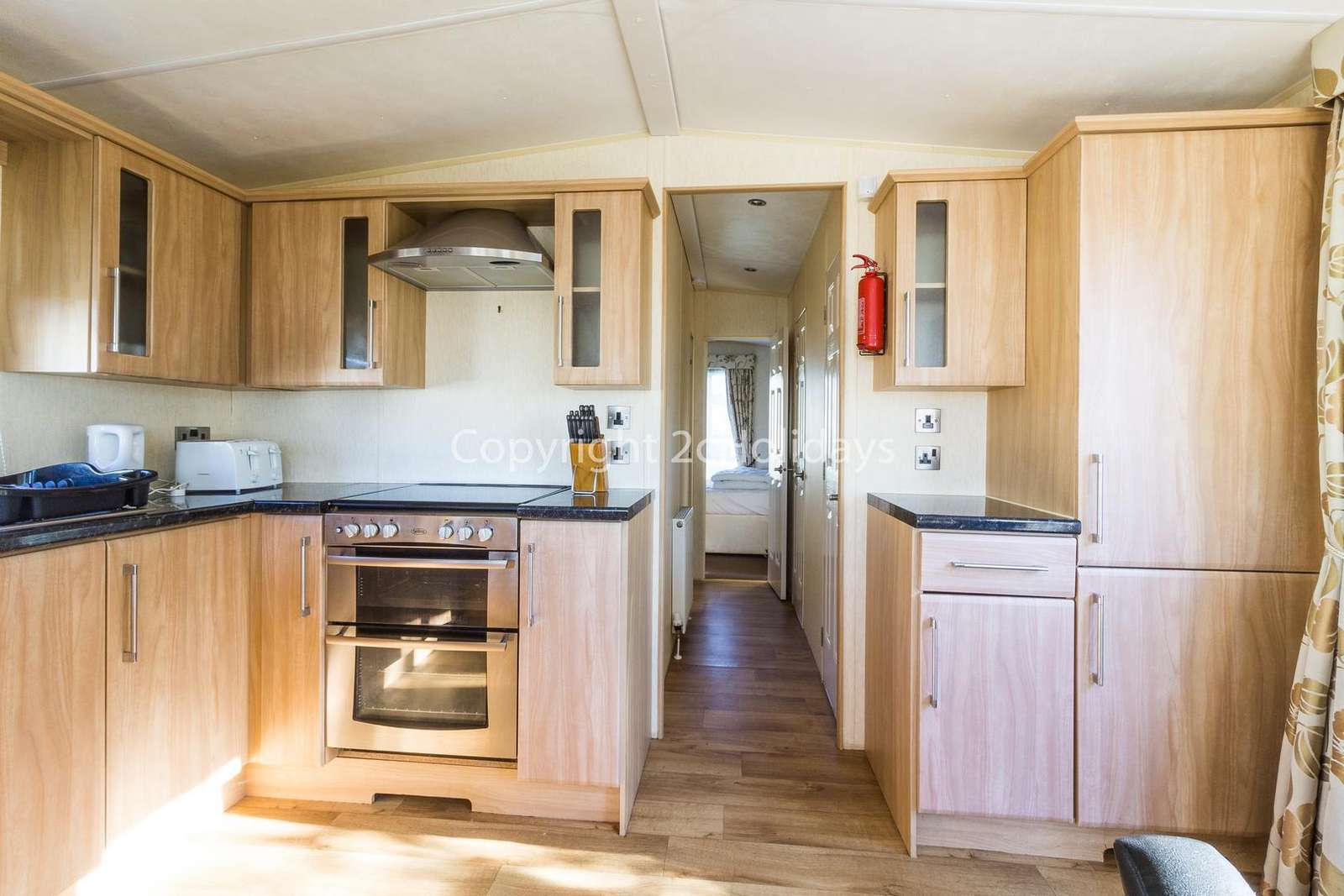The kitchen includes a full size oven and full size fridge/freezer!
