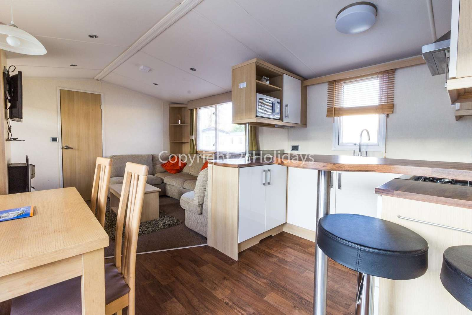The kitchen has a mini breakfast bar as well as a dining table ideal for families!