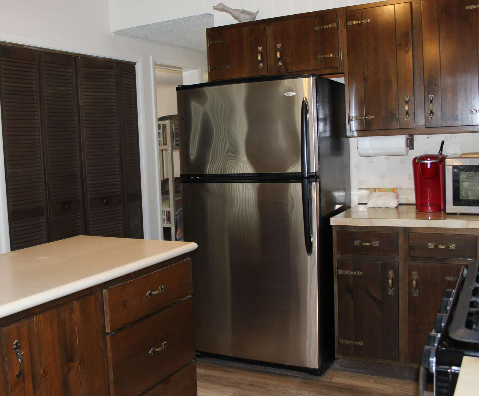 Kitchen with Stainless Steel Refrigerator and Island