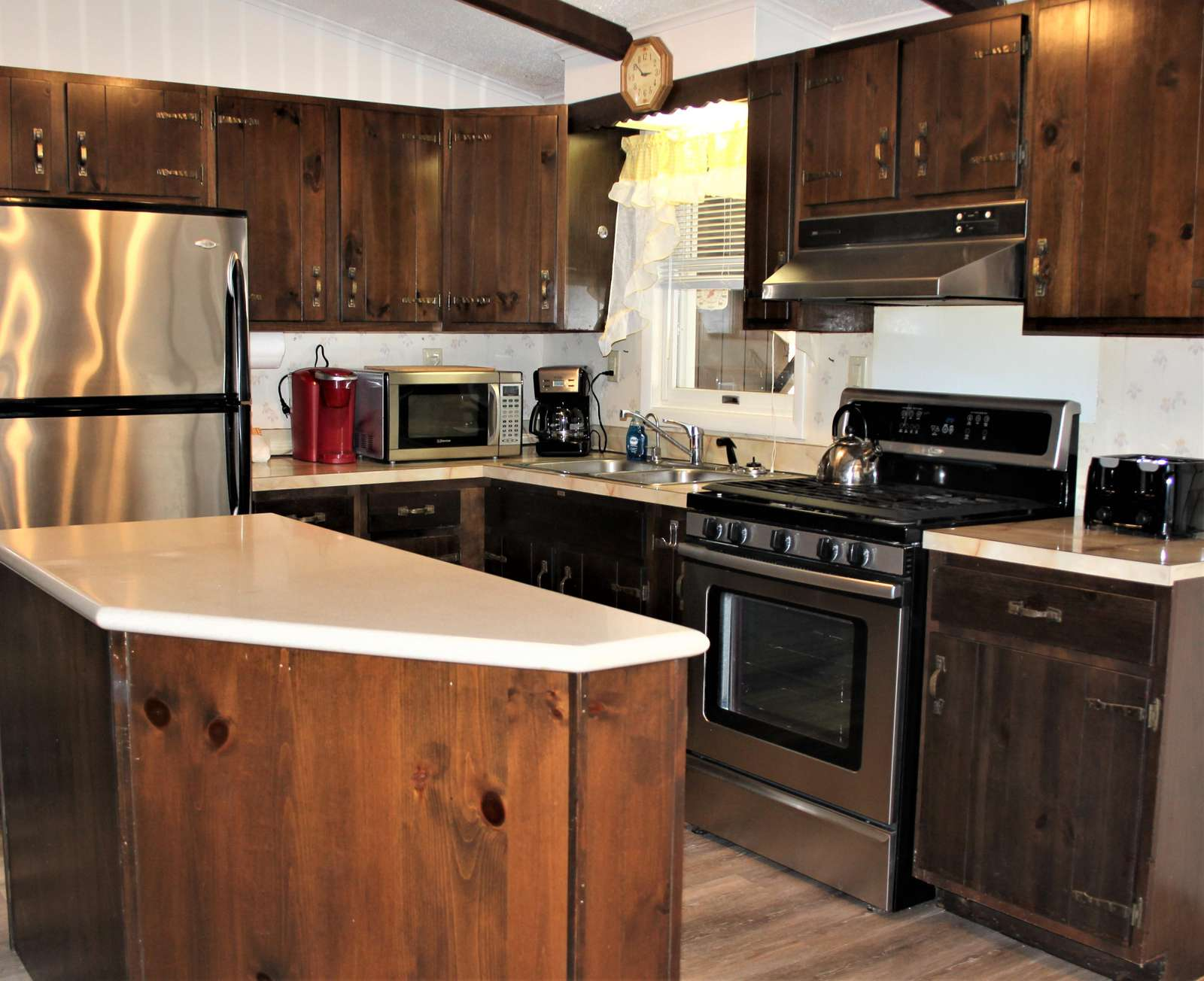 Another View of Kitchen Island, Stove, Refrigerator and Counters