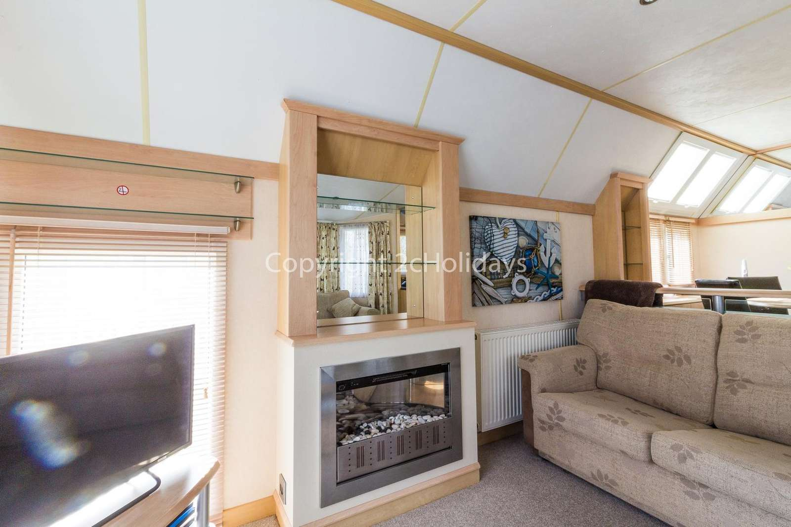 Lovely gas fire giving a homely feel to this caravan