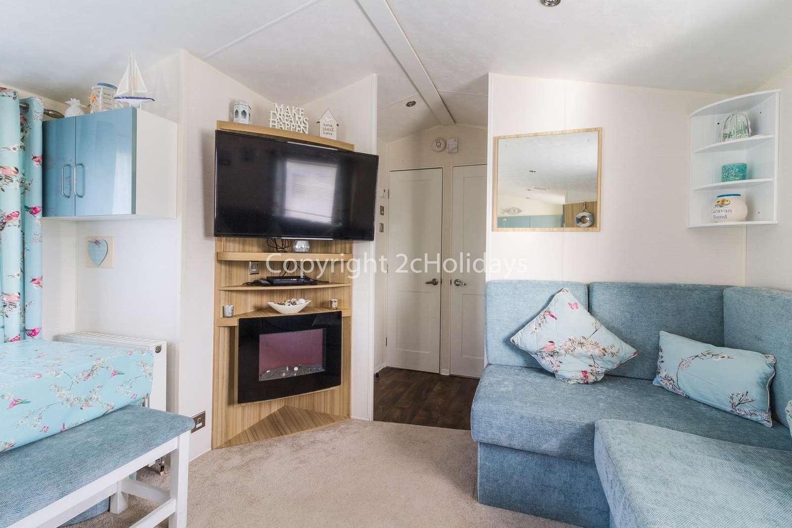 The lounge area includes a TV and a double sofa bed!