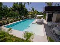 Shared pool area with loungers, BBQ and community orchard thumb