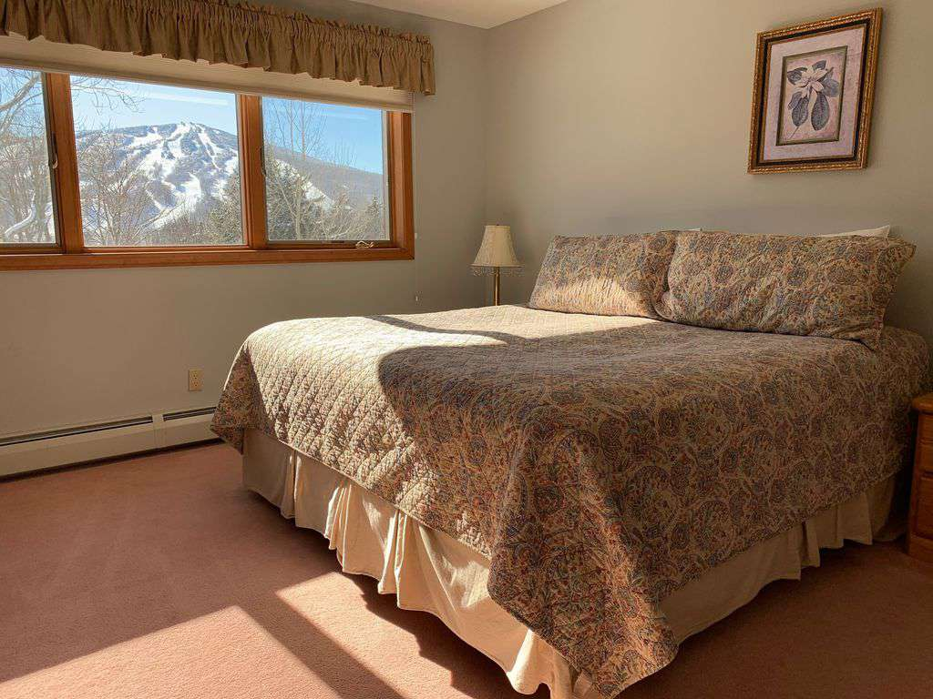 Private top floor master with stunning views of Mount Snow.  Also has a ceiling fan for summer comfort.