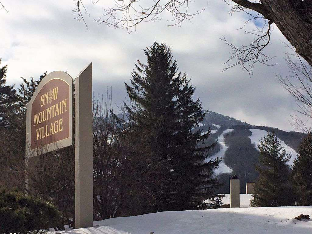 Welcome to Snow Mountain Village in front of Mount Snow