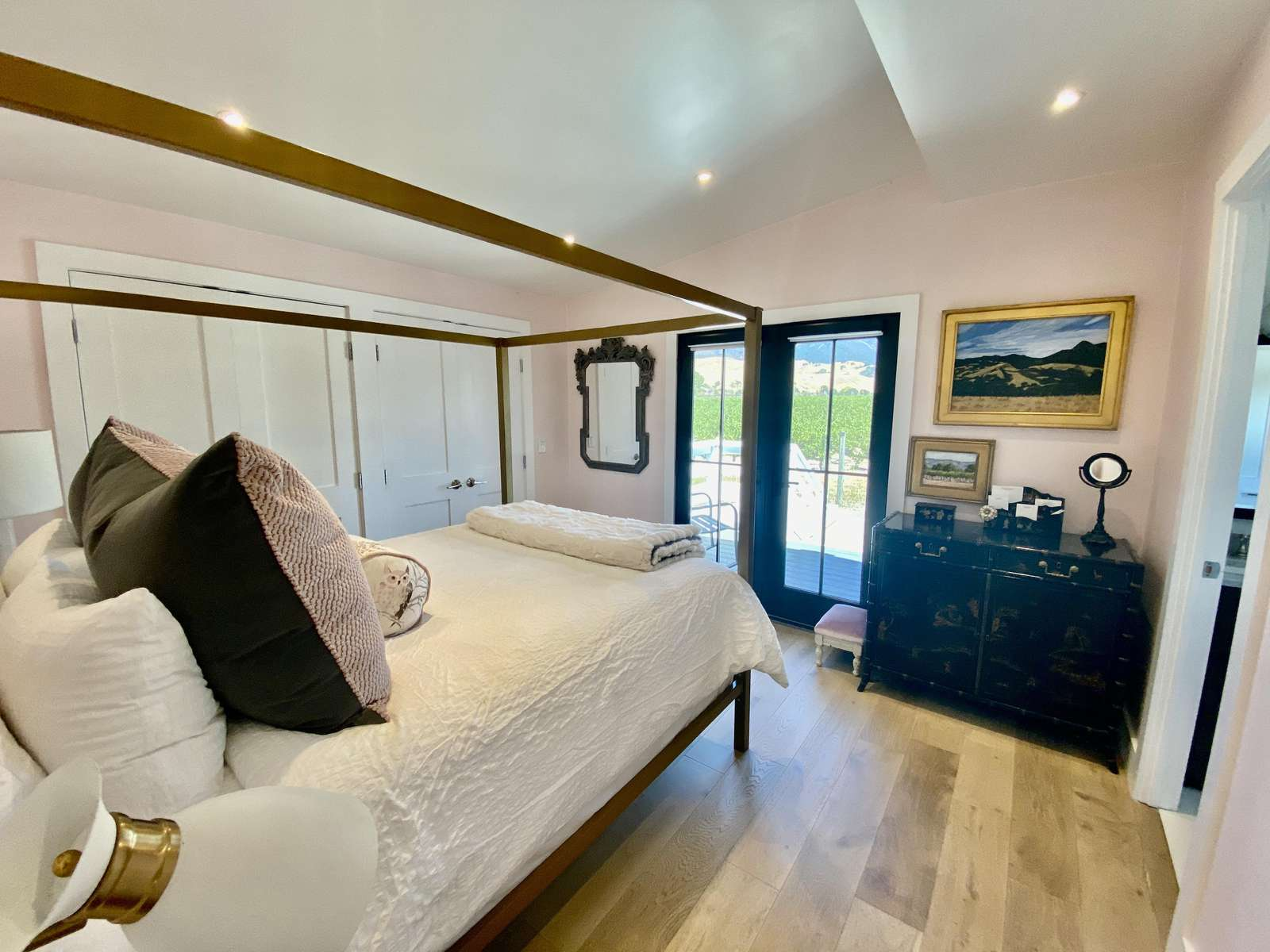 Master bedroom with view to courtyard