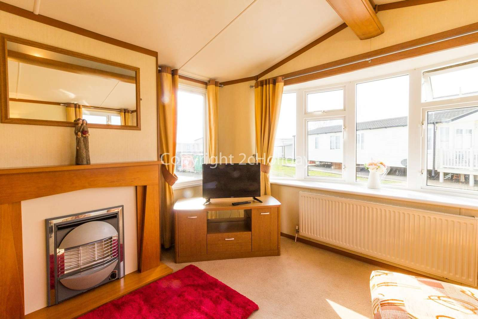 Relax in the living area with a TV and electric fire