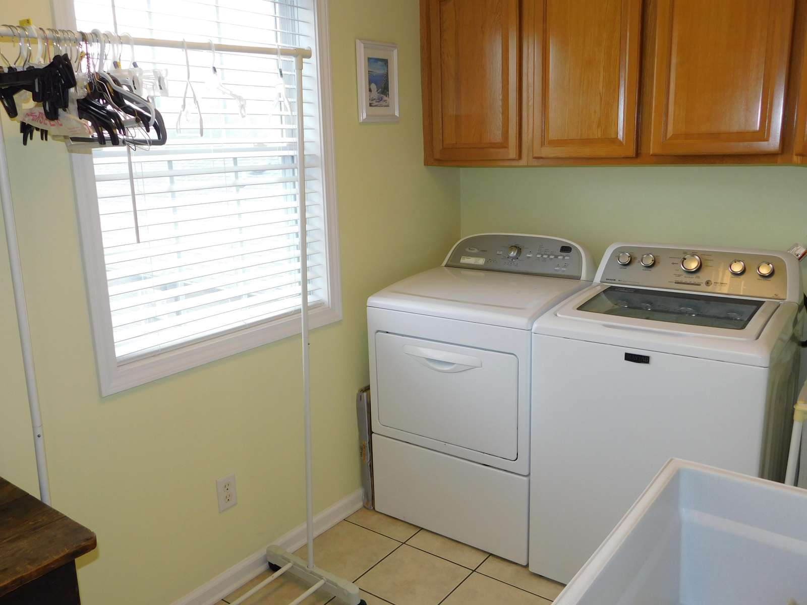 Laundry room with ironing board and iron
