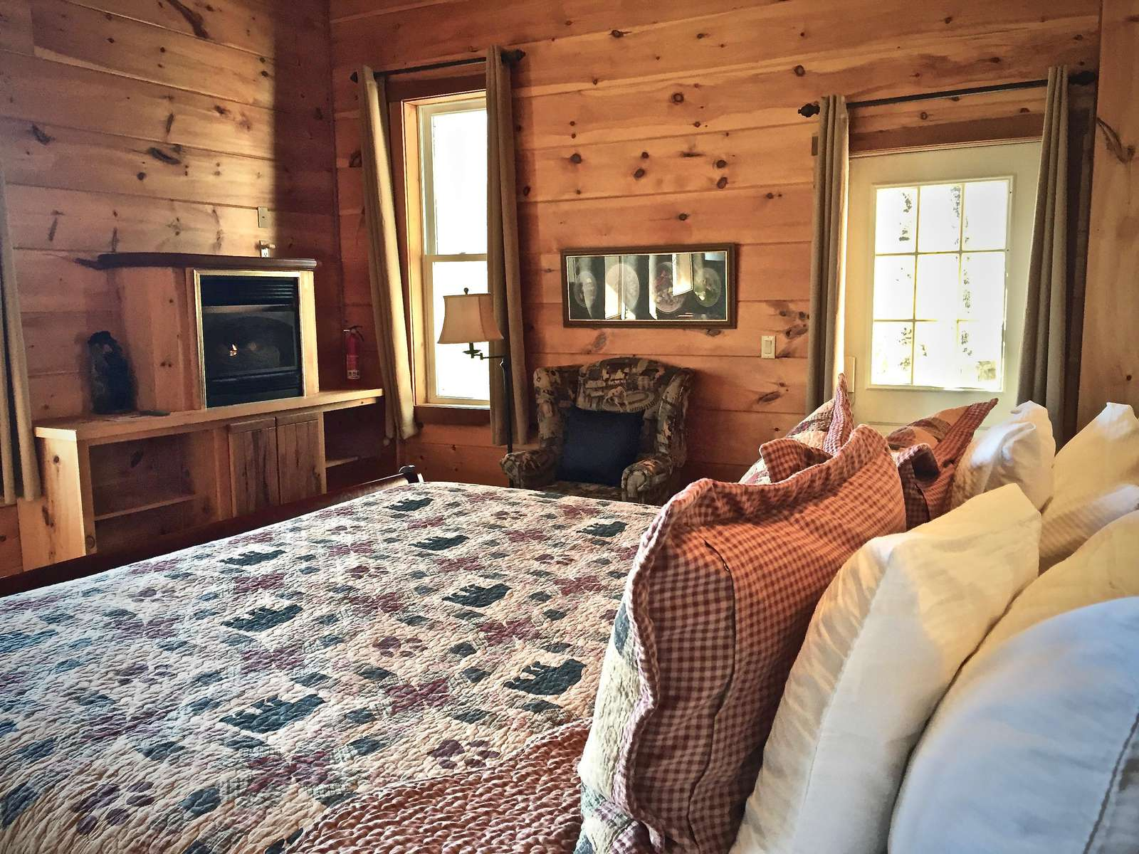 King Bed offers Pillow Top Mattress, Luxury Linens and Bedding, and the second Fireplace