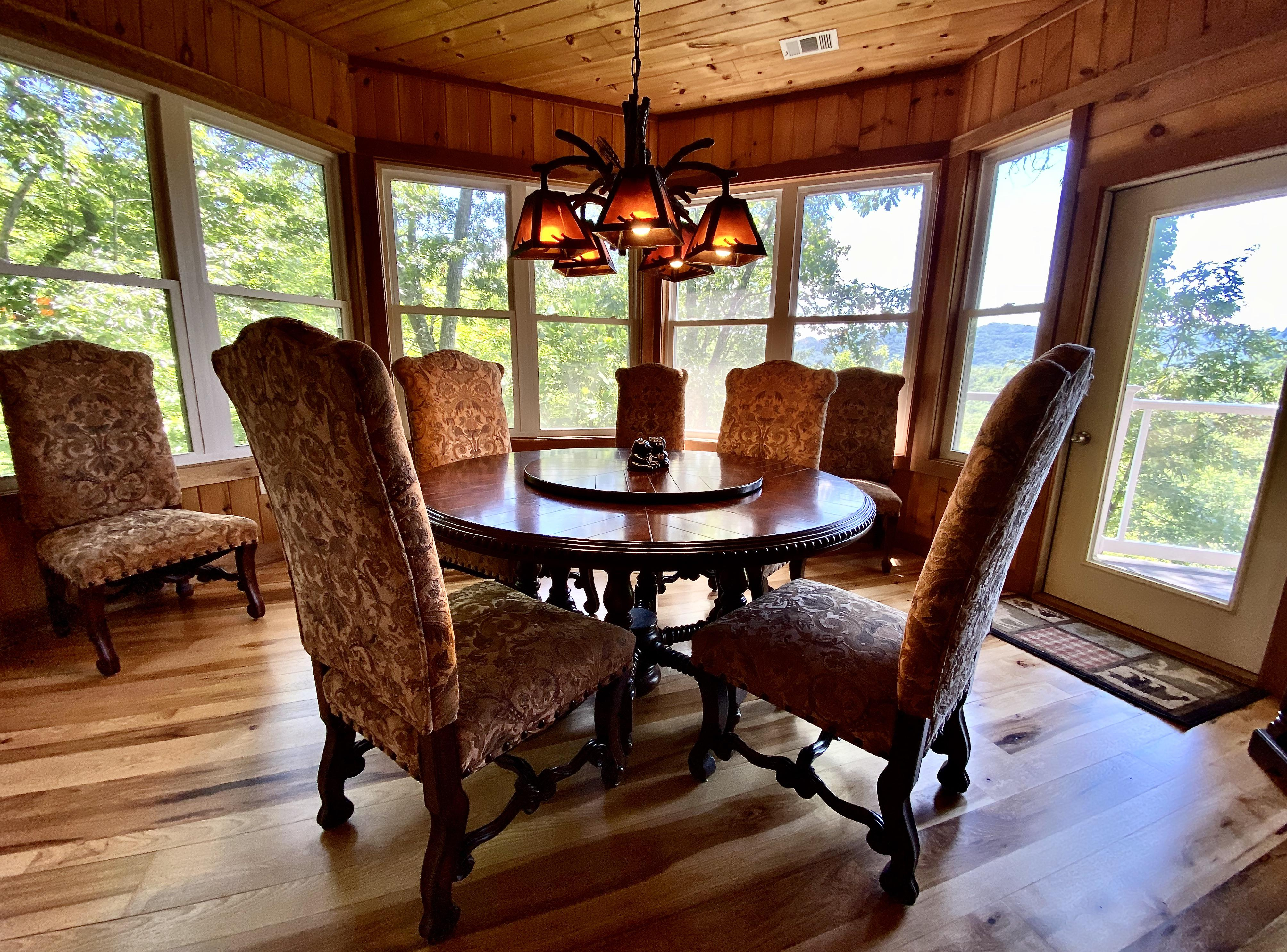 """Dining Room offers a """"Lazy Susan"""" Style Table, and opens to the Great Room/Kitchen"""