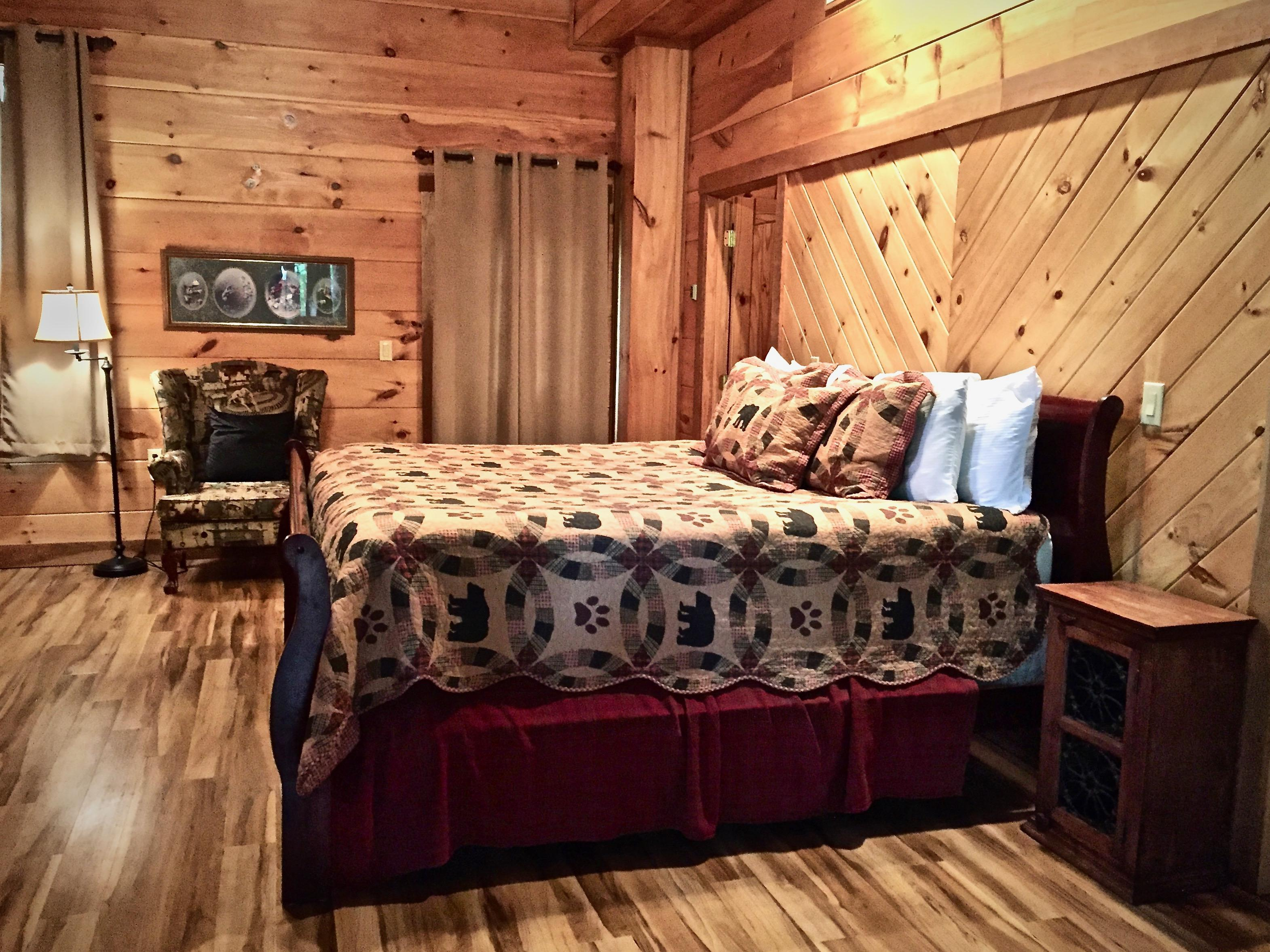 King Suite offers a third Flat Screen TV, access to the Hot Tub Deck, Fire Pit, Media Room