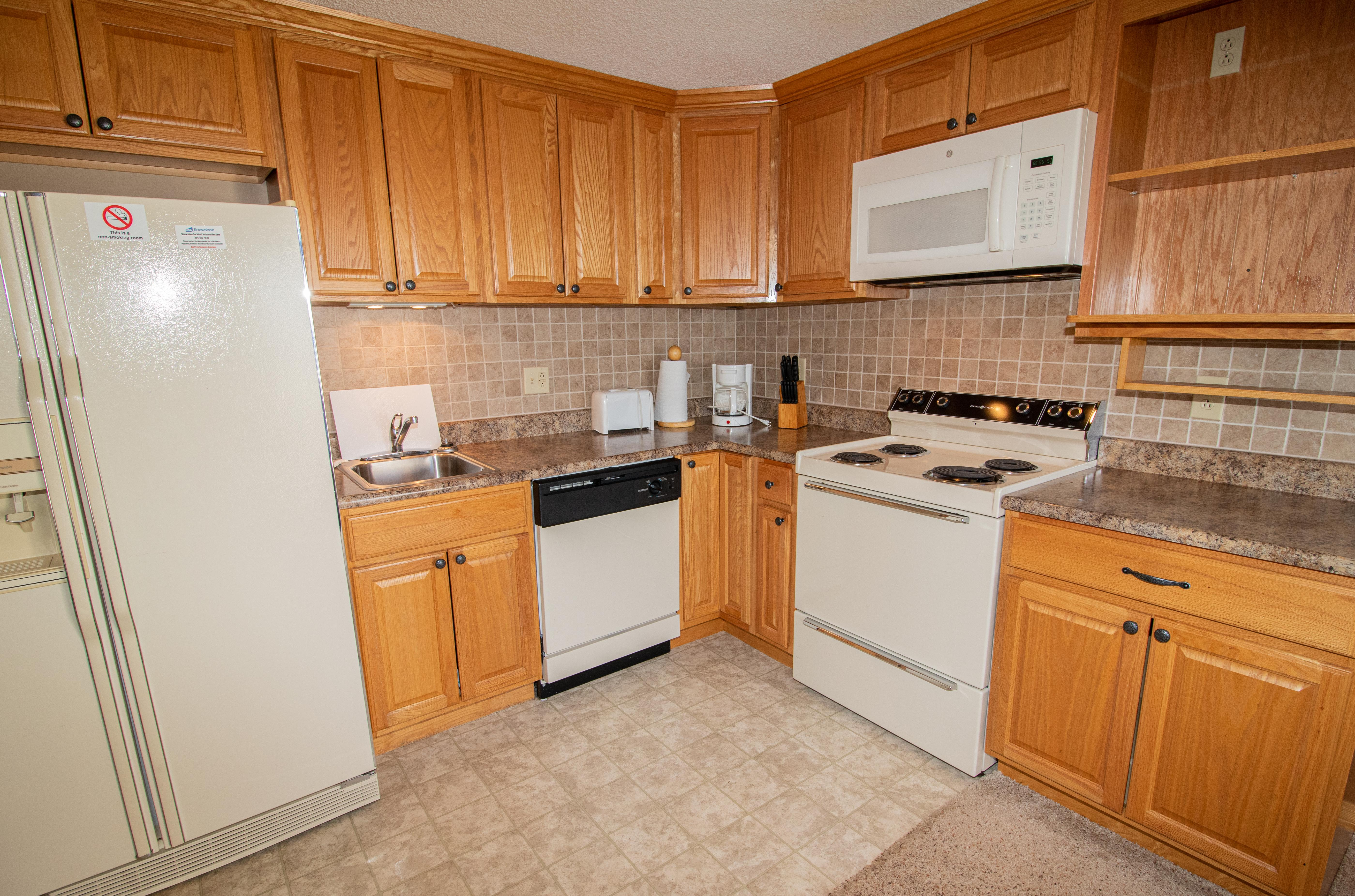 Remodeled kitchen is fully equipped - cook meals in your condo!