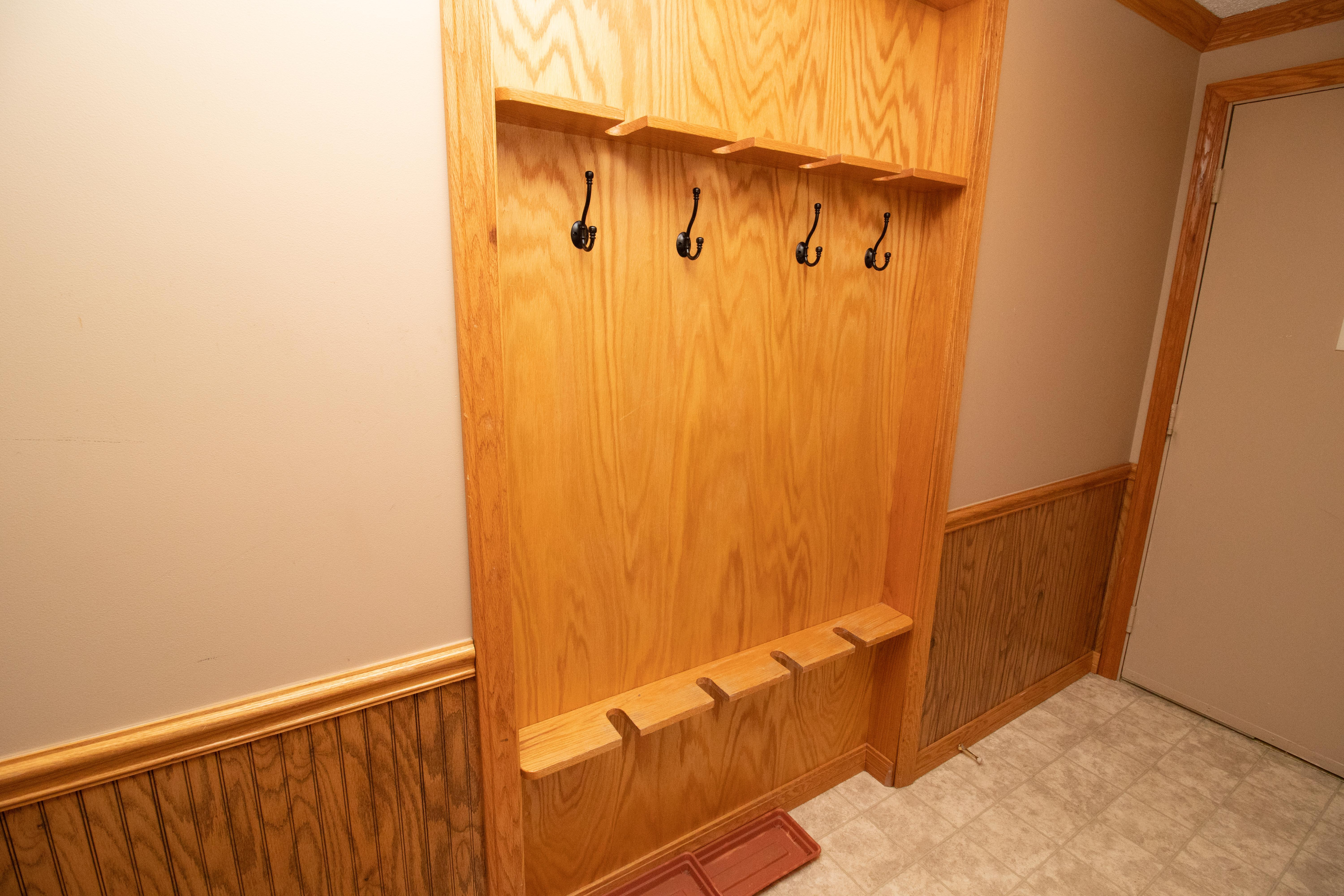 Safely store your gear inside the unit; recessed oak ski rack in hallway