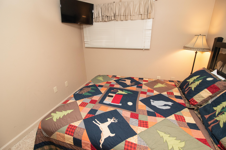 Flat screen TV in bedroom; free DISH Network channels.