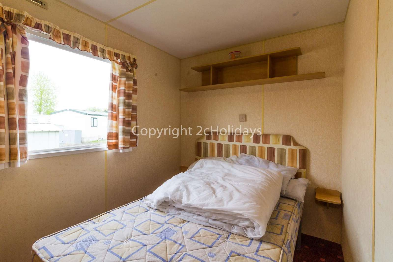 Great size master bedroom with an electric heater