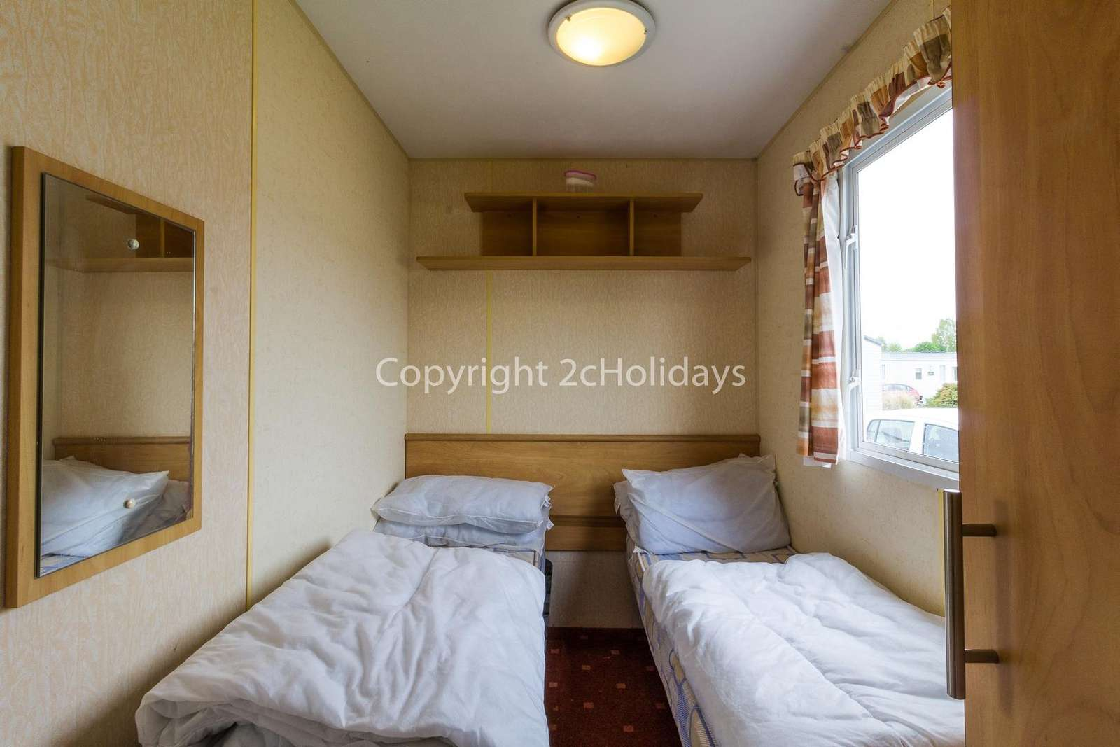 Cosy twin bedroom with an electric heater
