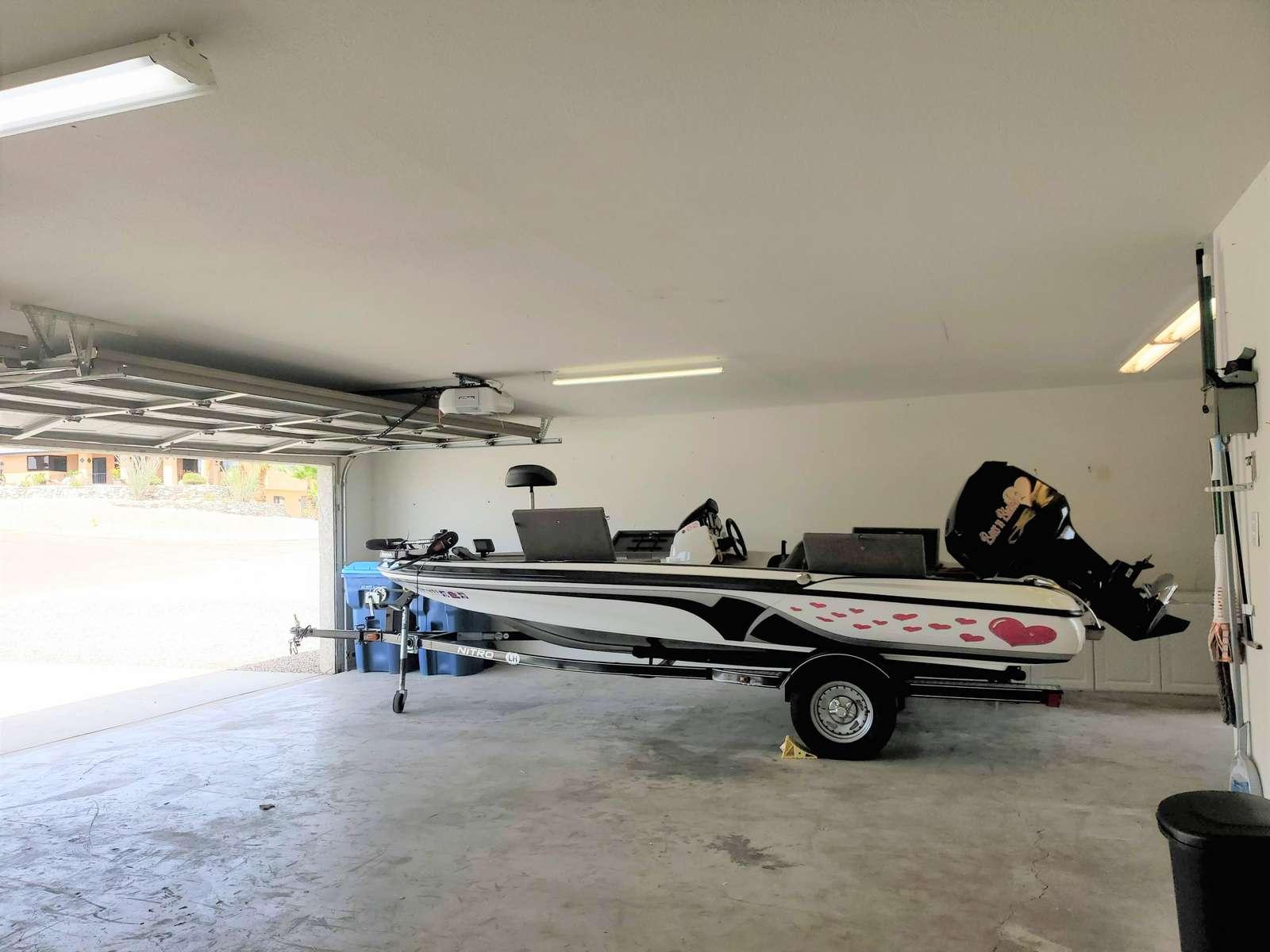 3 Car Garage - 1 30' Boat Space