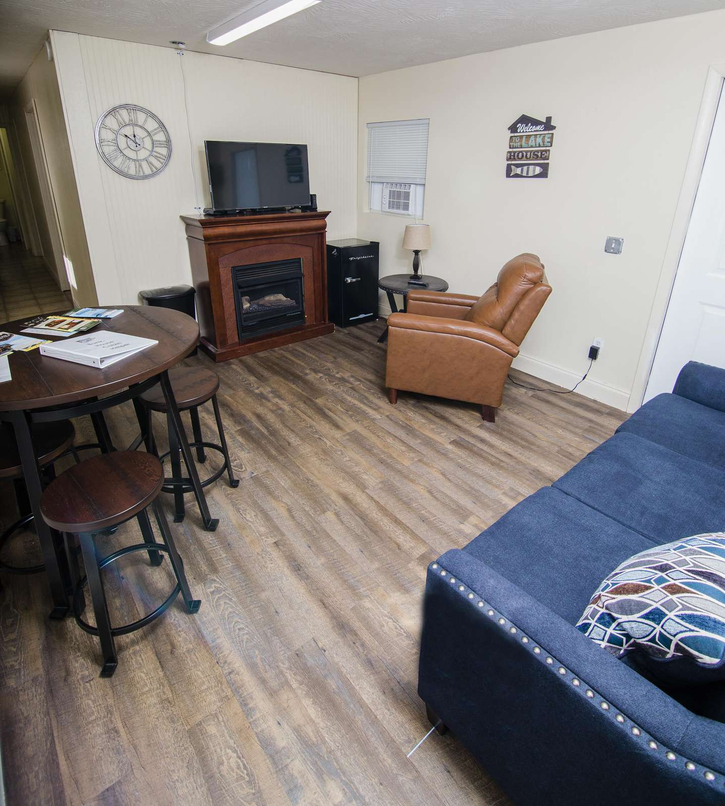 Bunk House: Living area with flat screen TV, DVD, electric fireplace, electric recliner, and Queen sleeper sofa