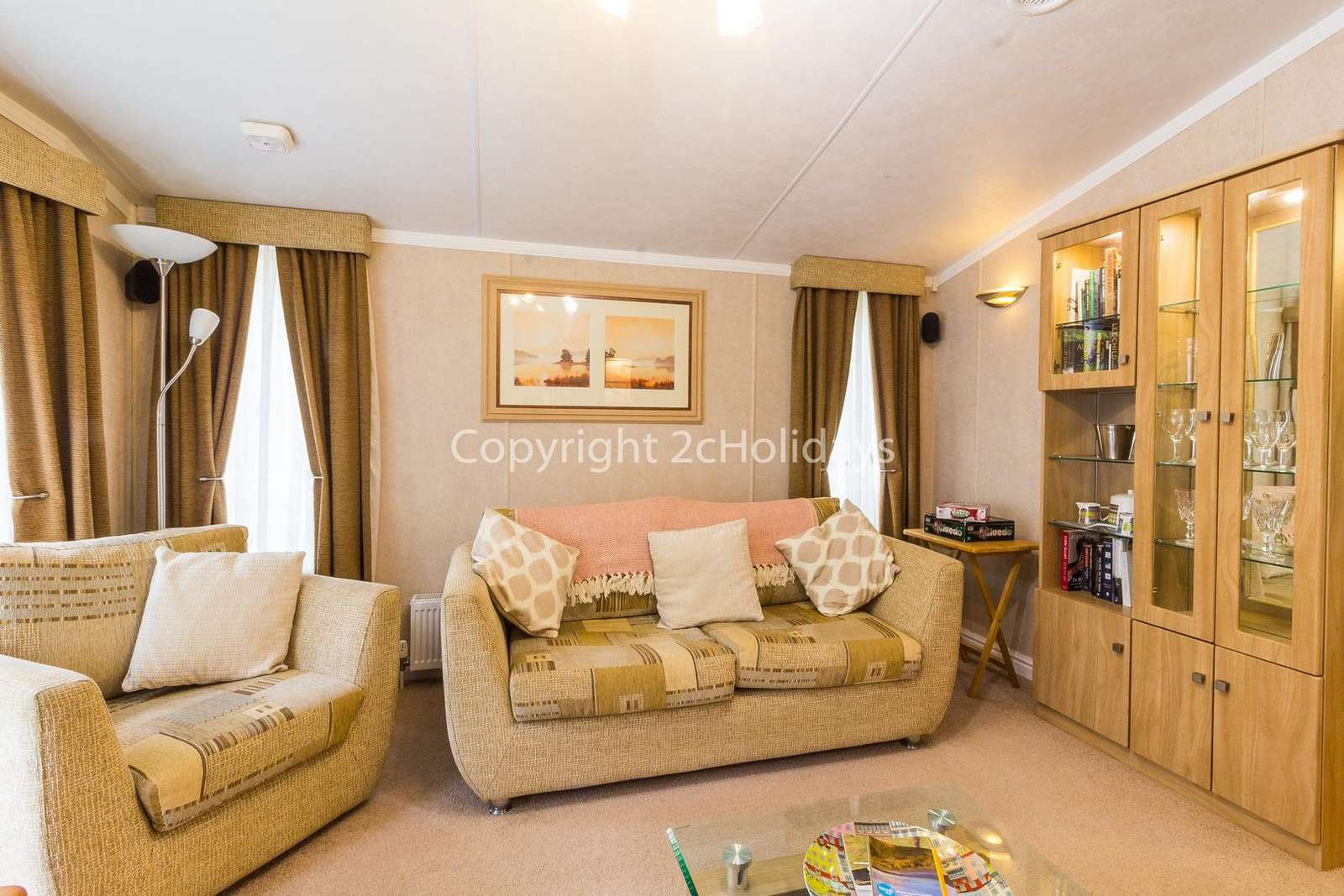 You can relax in this lovely lounge which comes with an electric fire and books to enjoy