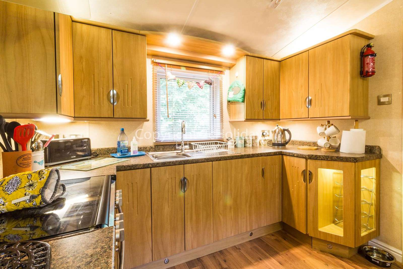 This kitchen includes a full size oven and a washer/drier!