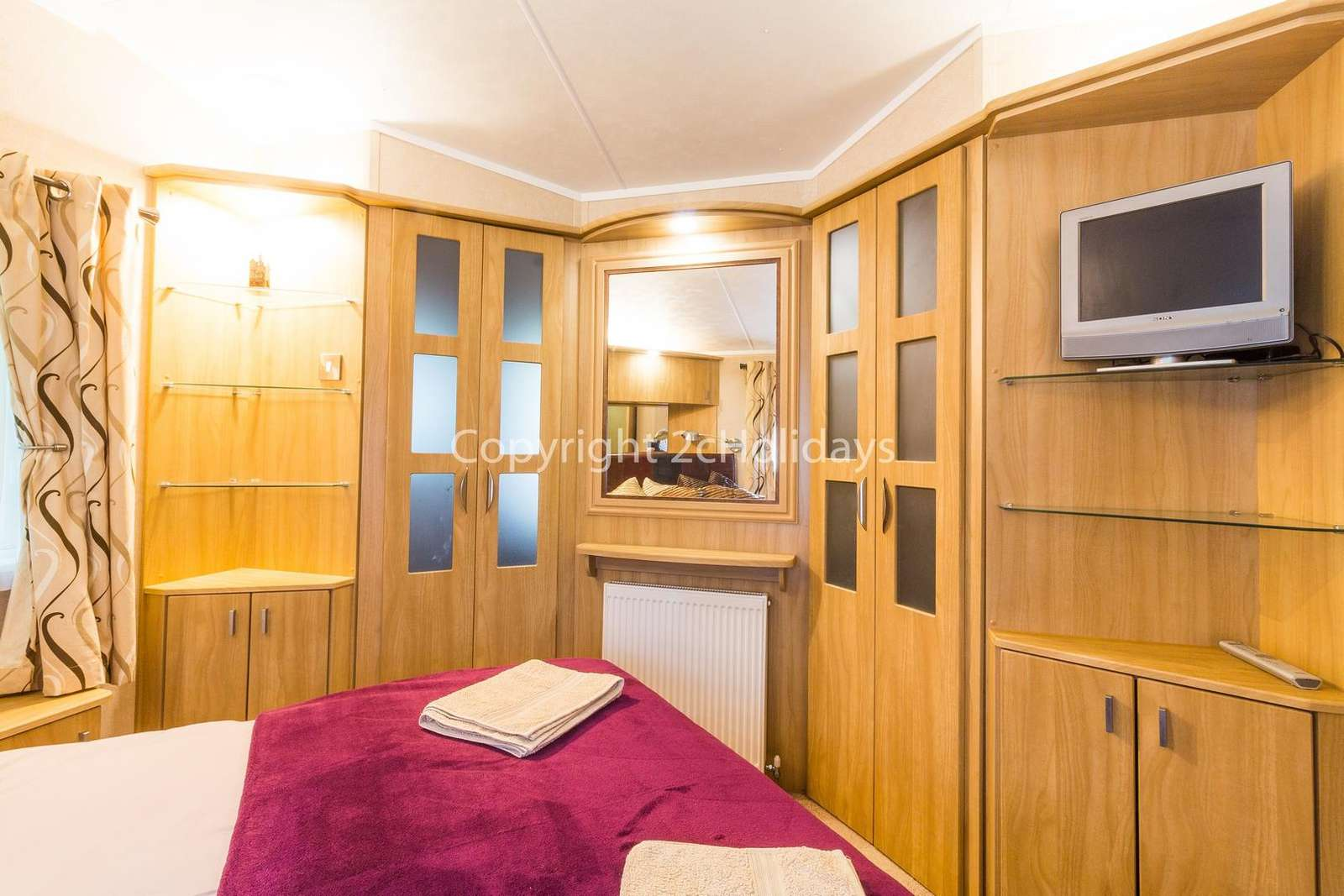 You can find plenty of storage in this master bedroom as well as a TV