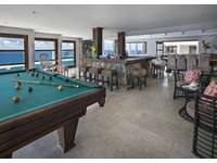 The pool table and bar area thumb