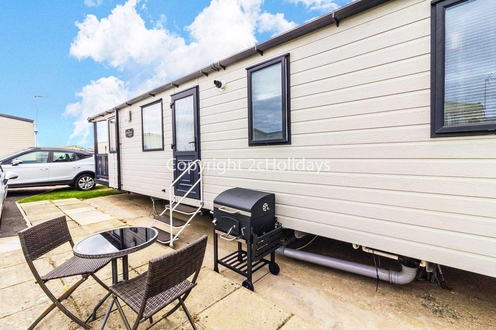 Relax and enjoy the use of outdoor furniture at this mobile home!