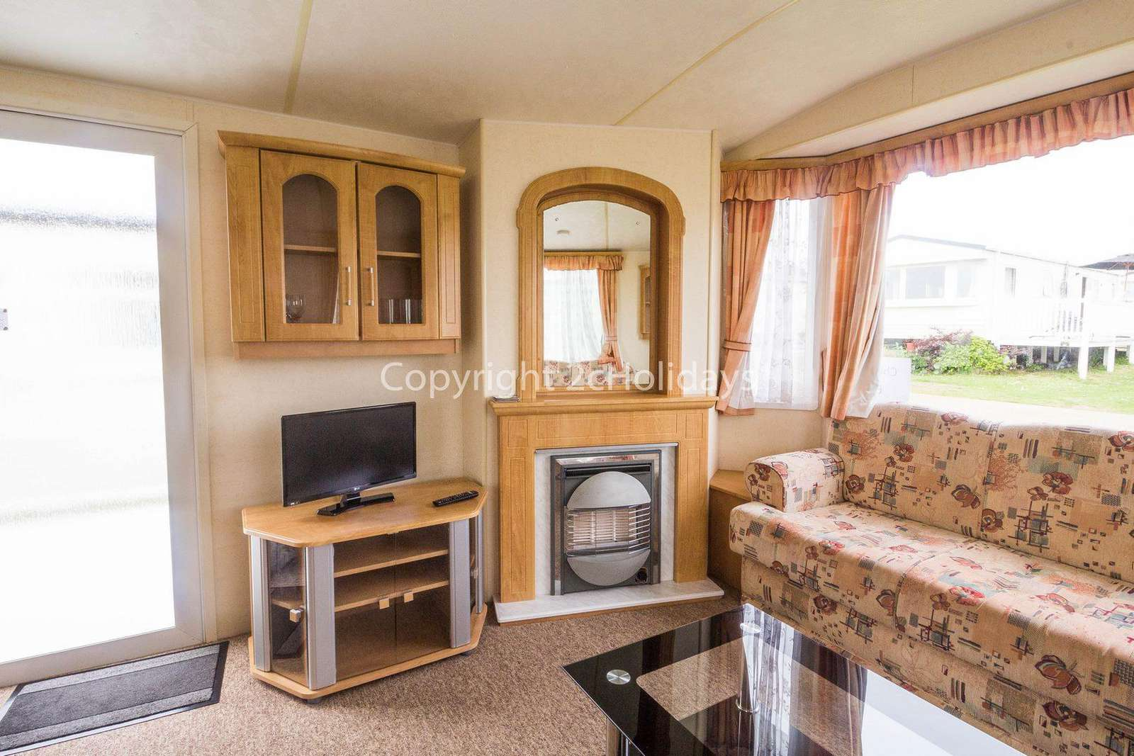 Spacious lounge with a TV/DVD player and electric fire!