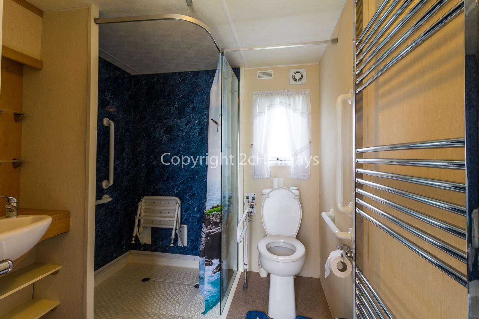 Spacious wheelchair adapted wet room with shower, toilet and wash basin!
