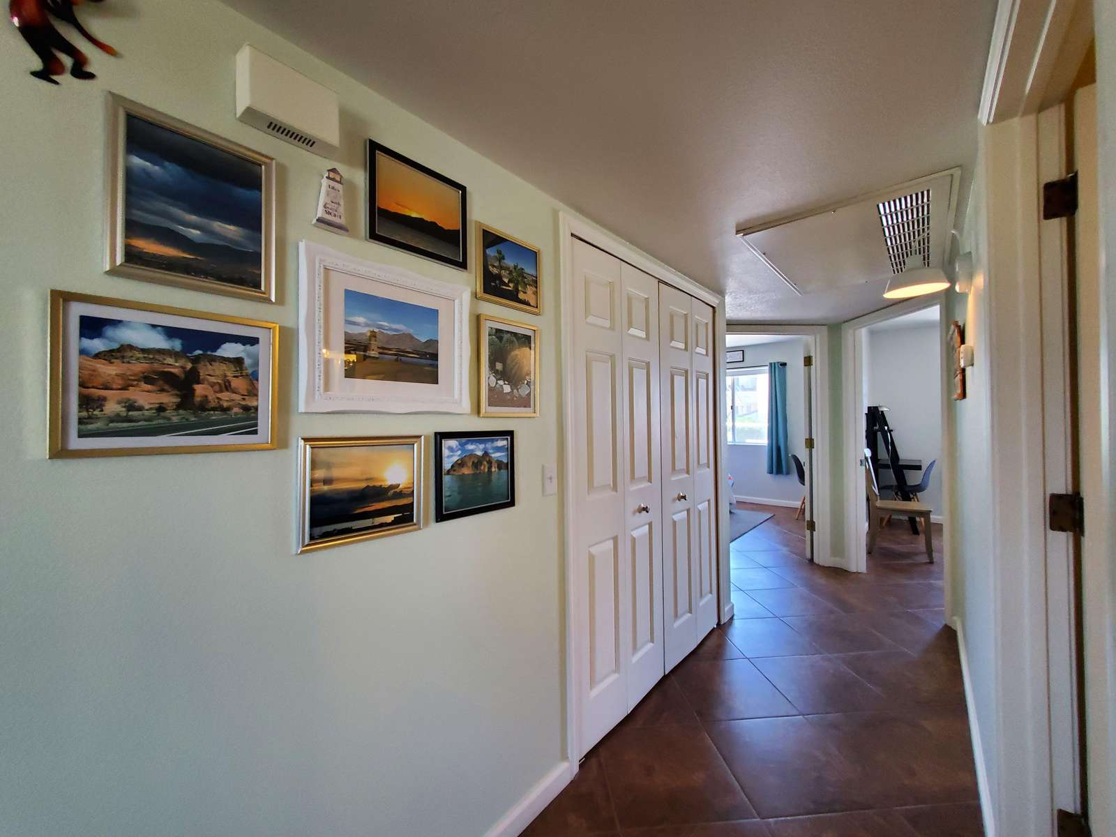 Hall Leads to Two Bedrooms