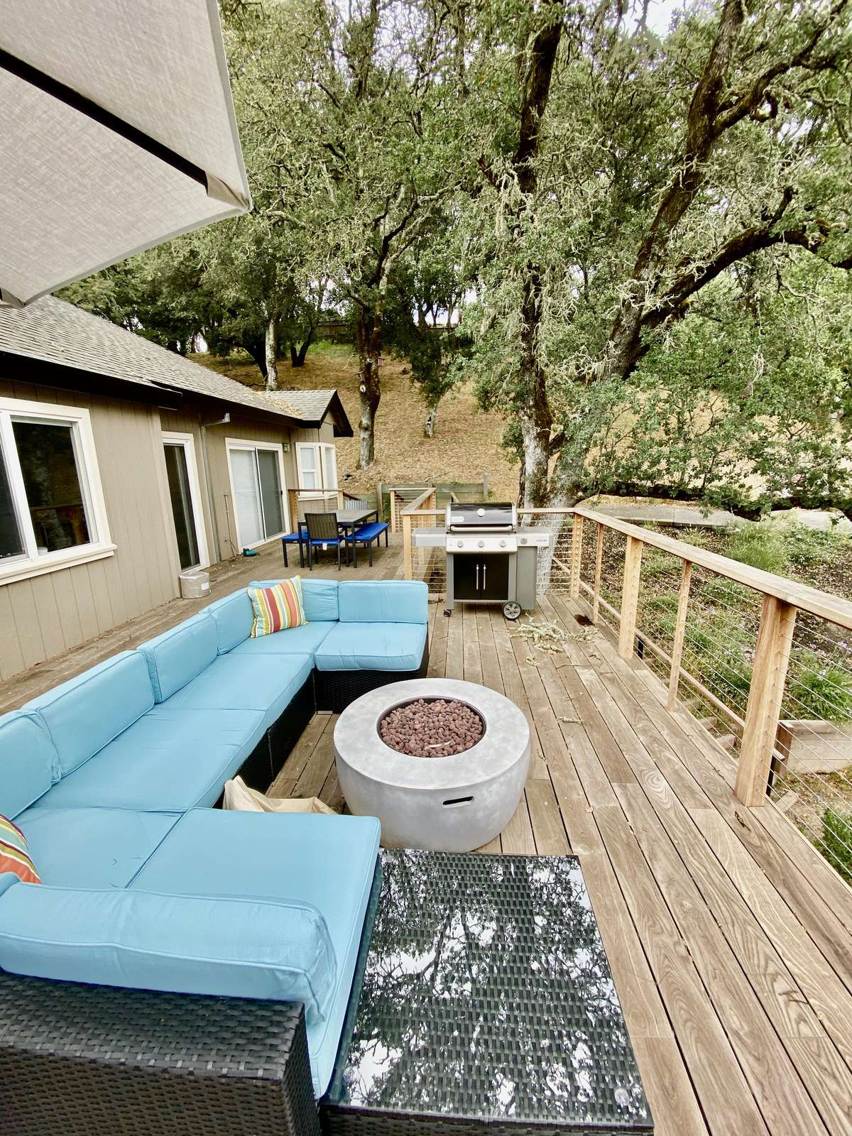 Expansive deck with lounge, fire pit and Weber BBQ grill