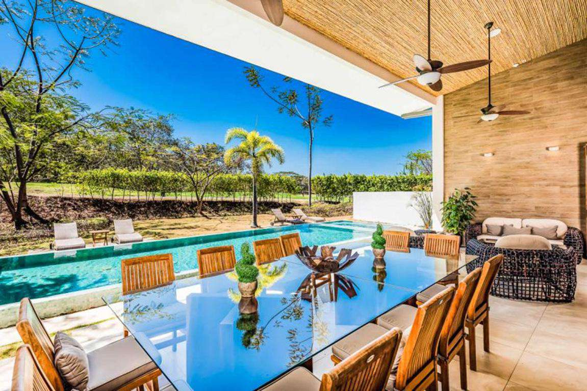 Outdoor dining area, pool and backyard