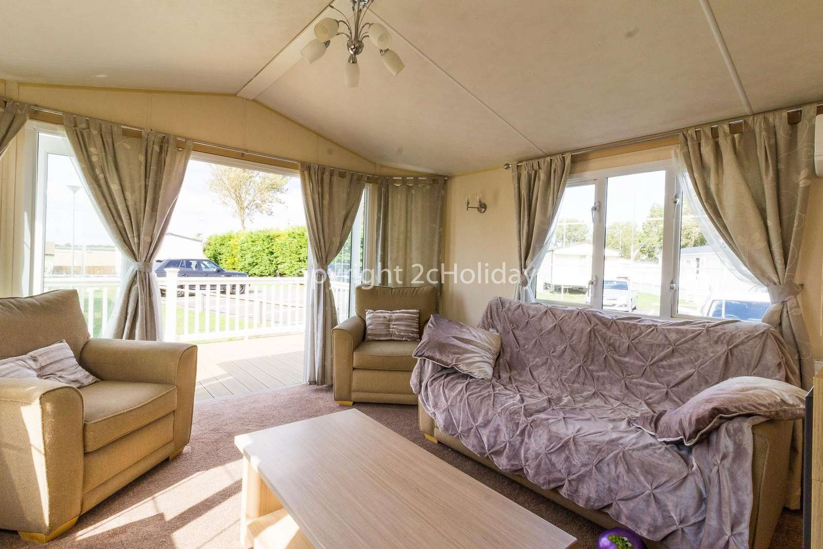 Luxury lounge with double doors leading to the decking area!