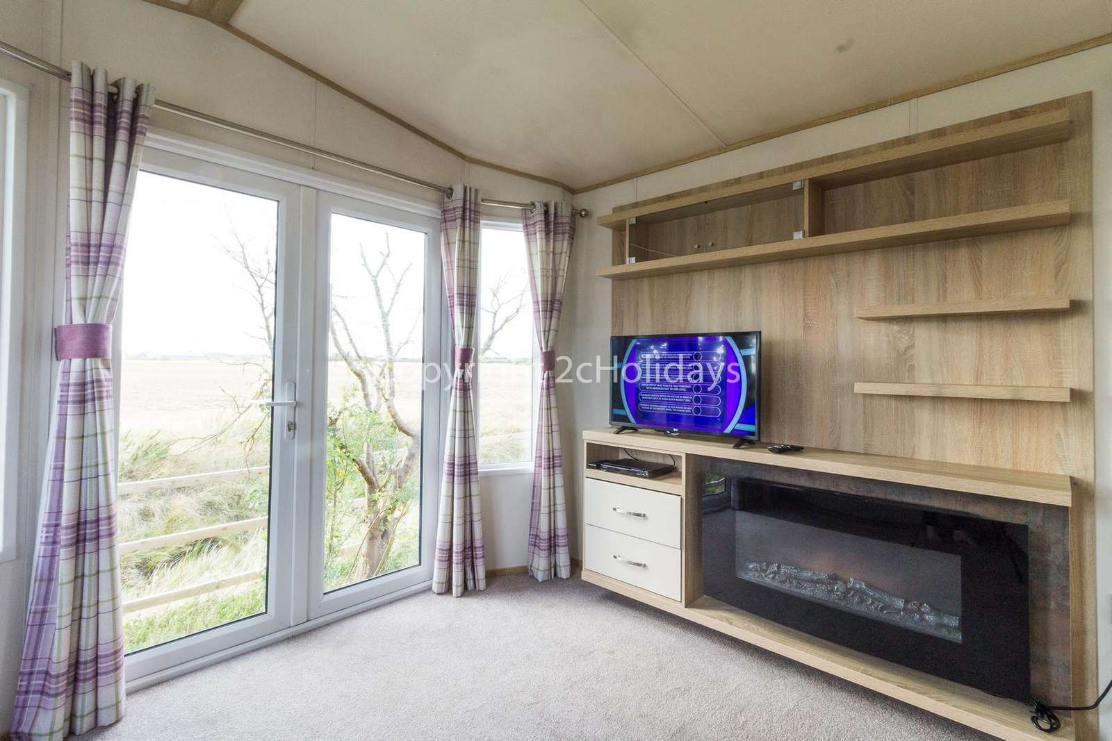Light and airy lounge area with a TV and electric fire!