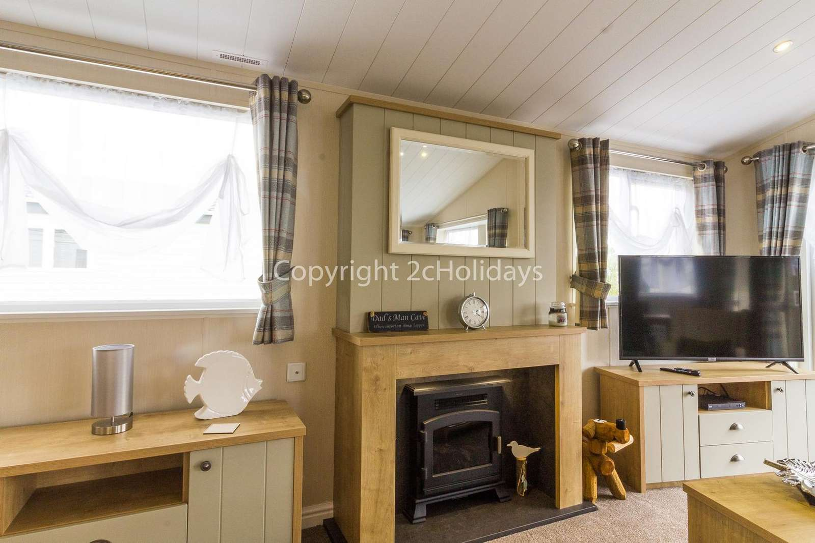 Homely lounge with a TV and electric log fire!