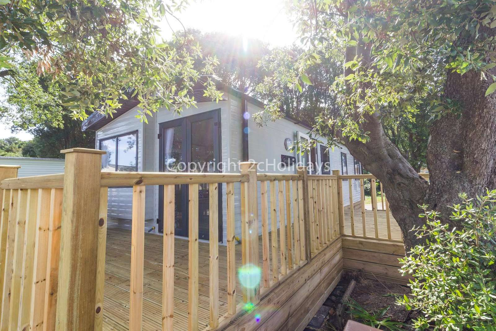 Large decking area with furniture to relax in the sun!