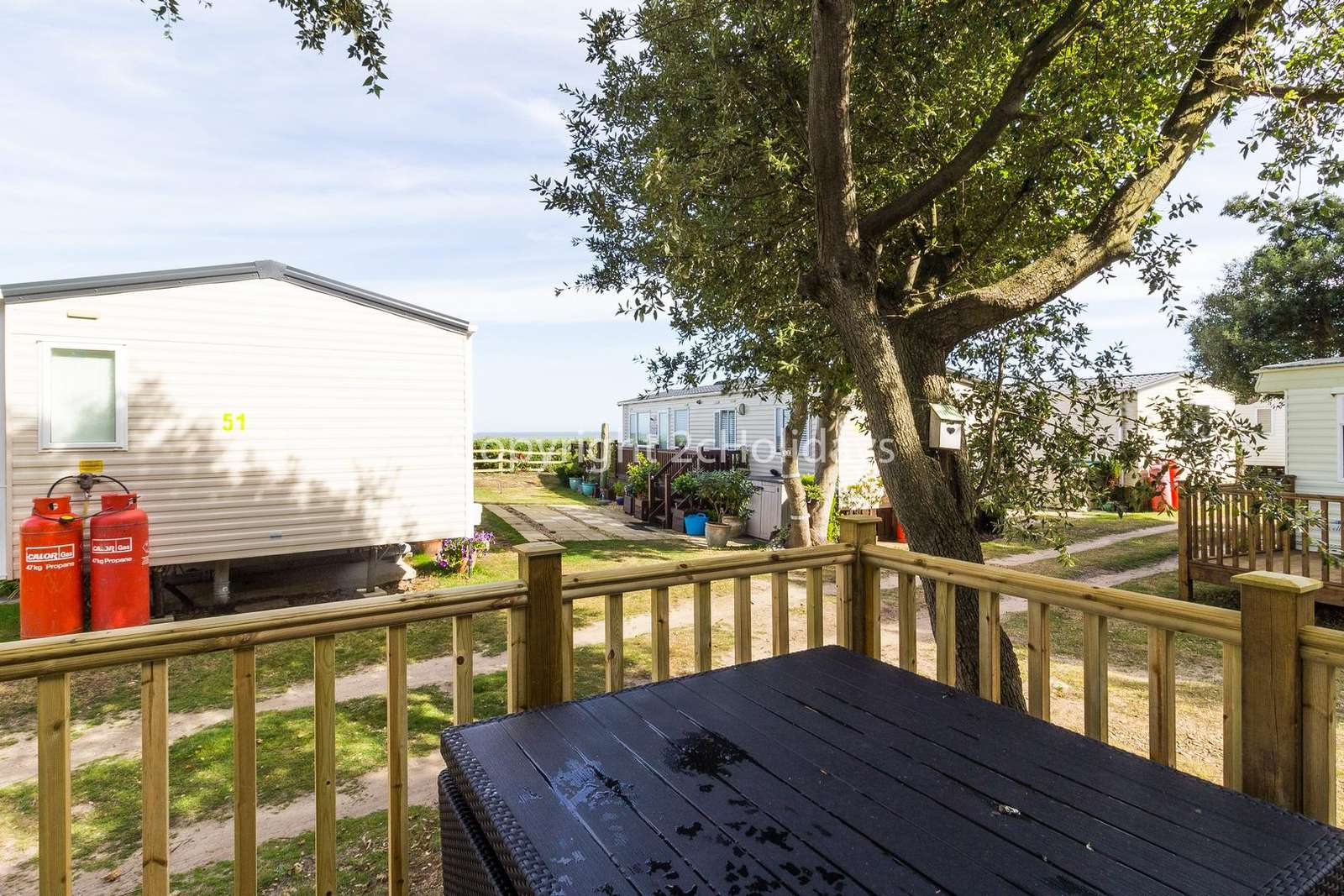 Relax on the decking furniture and enjoy partial sea views!