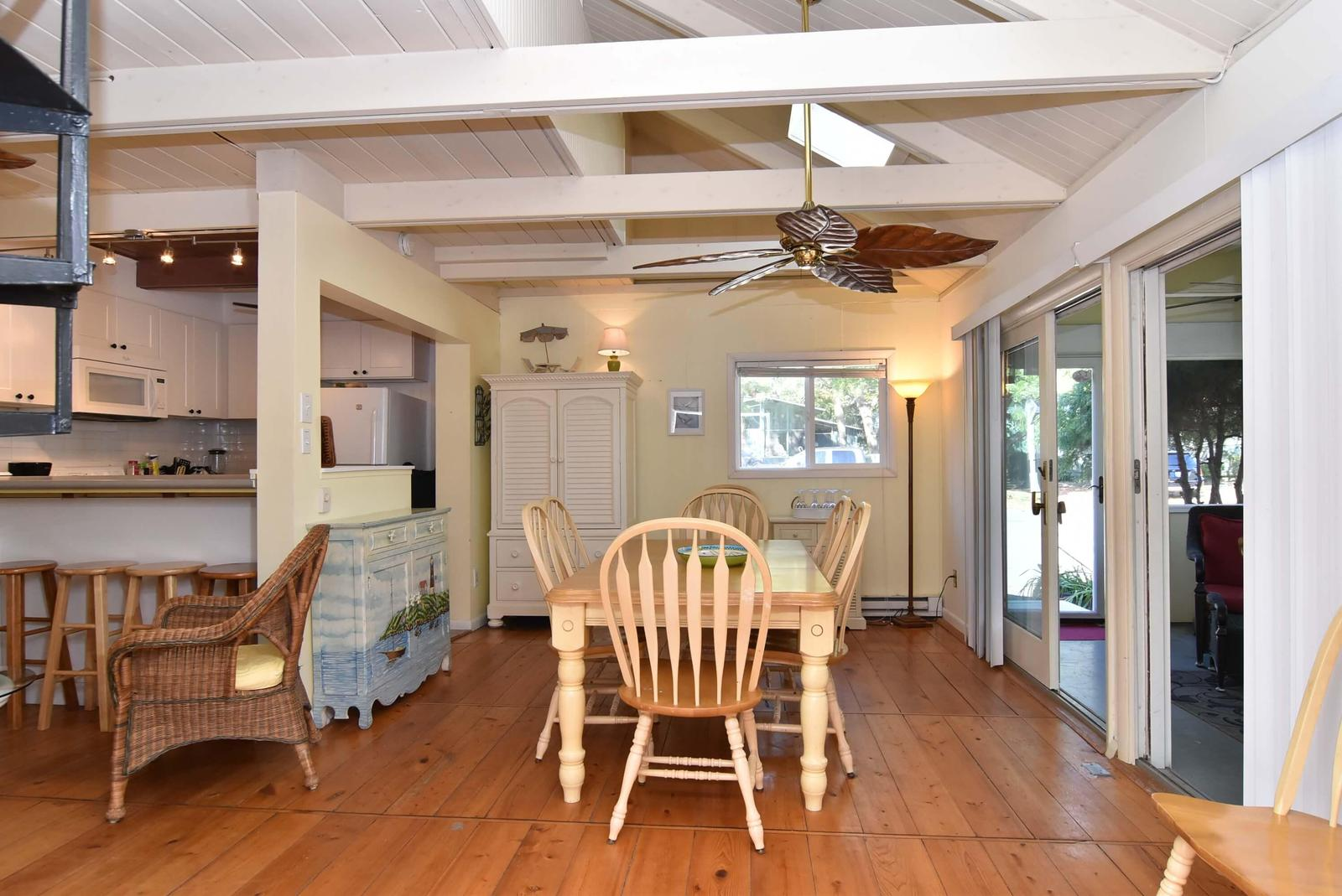 Dining room off kitchen, porch and sitting room with open ceiling and space for entertaining
