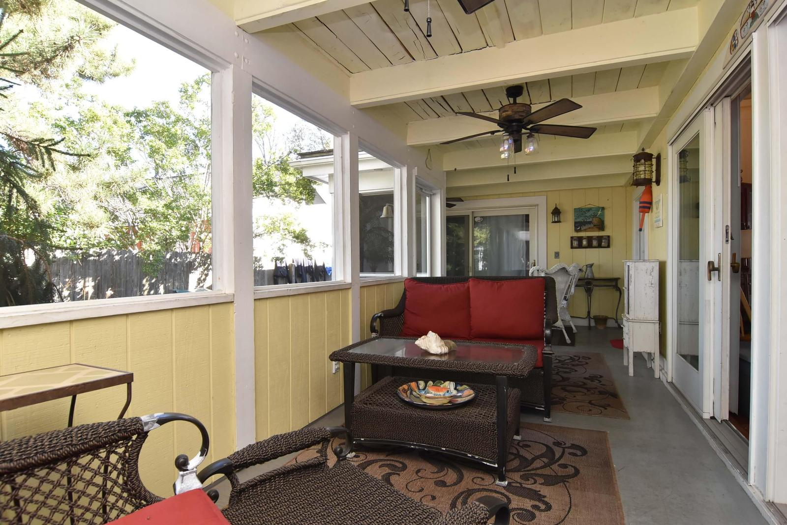 This cozy porch is just off living room, dining room and kitchen area