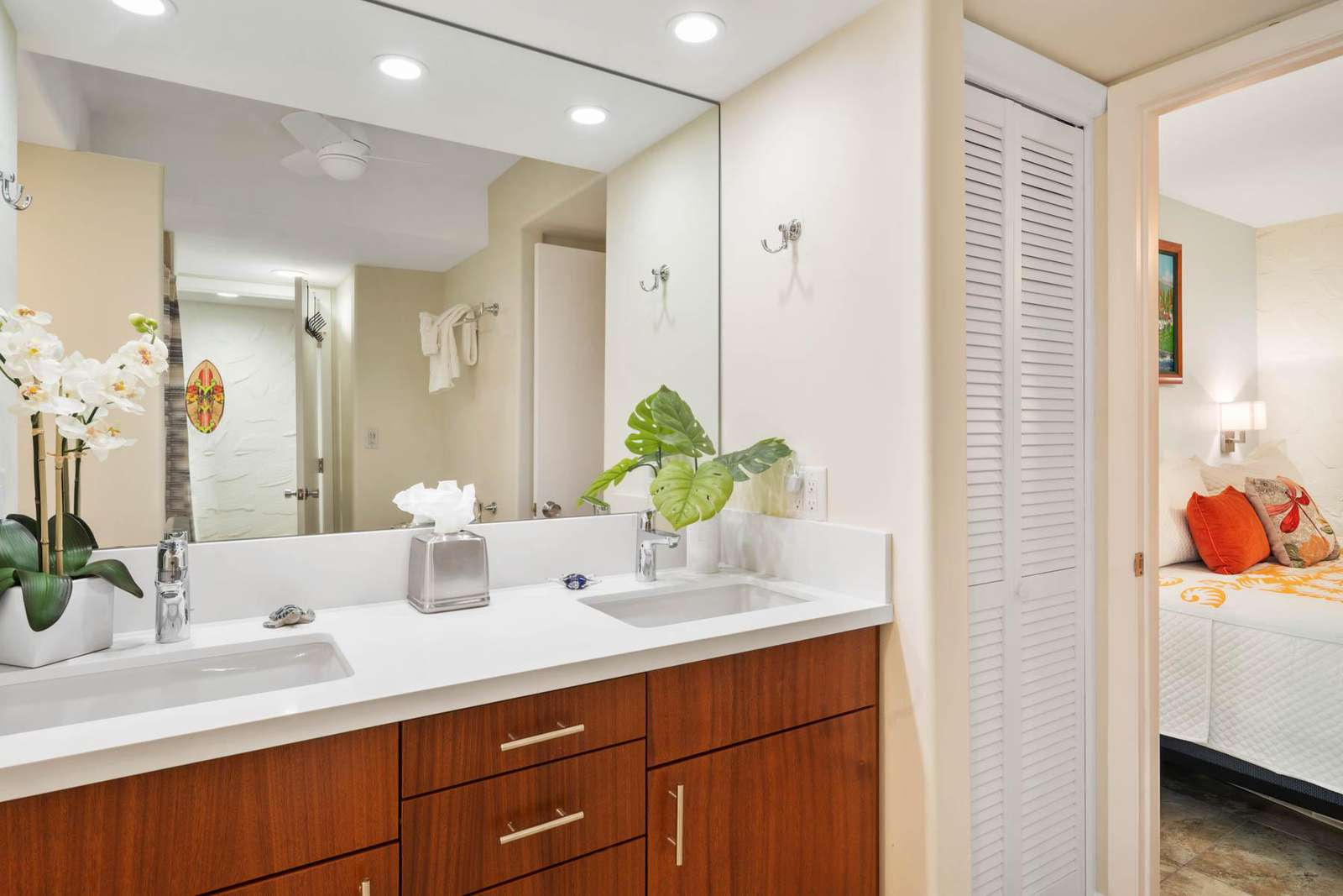 Pass-through bathroom with a good sized dual vanity.