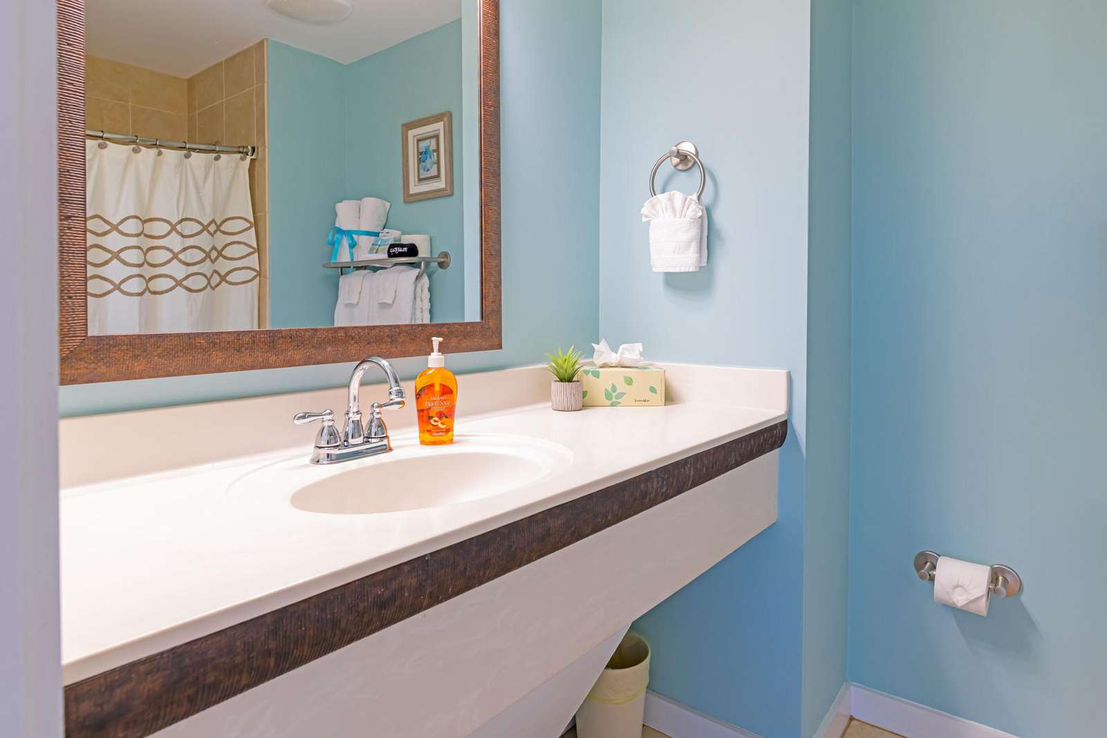 The cute beach decor and vibe carries into the bath!