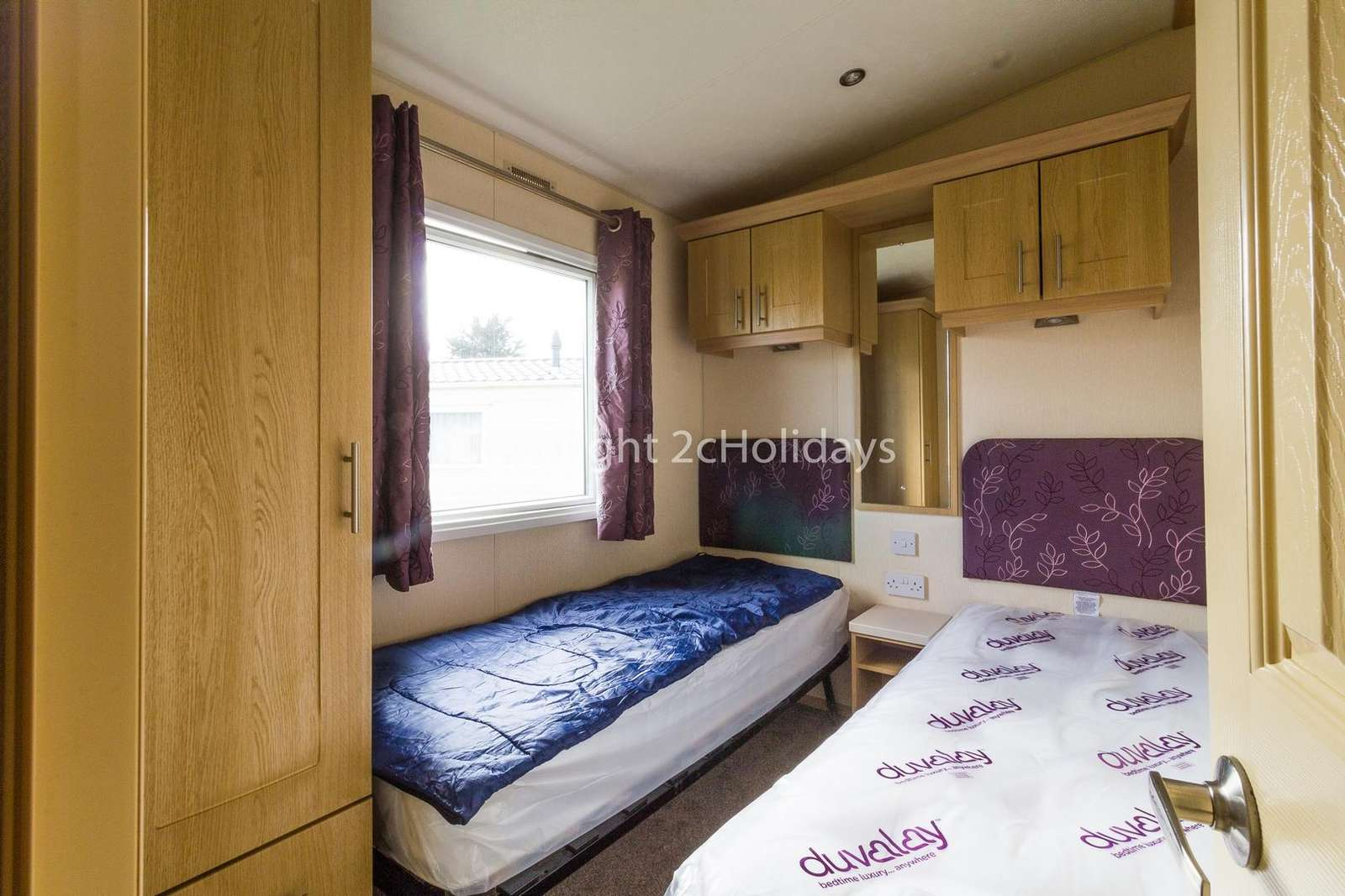 You can find plenty of storage in this twin bedroom