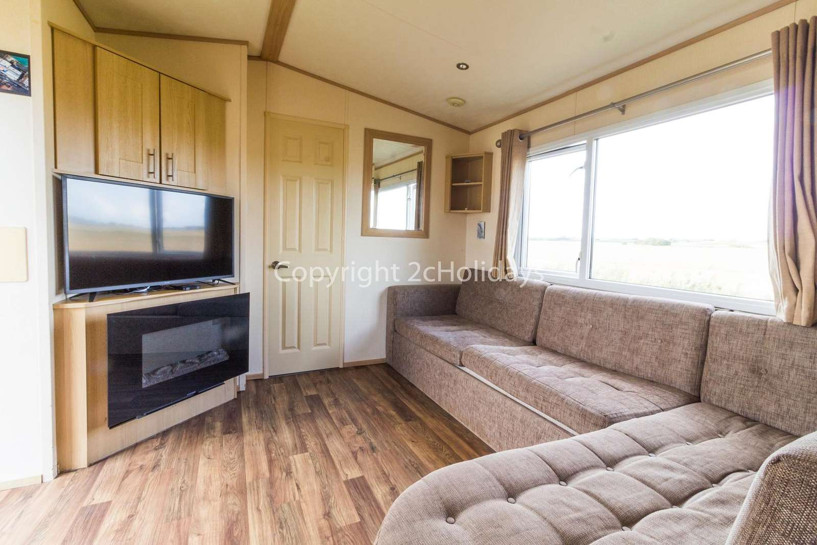 Spacious and modern lounge with a TV and an electric fire