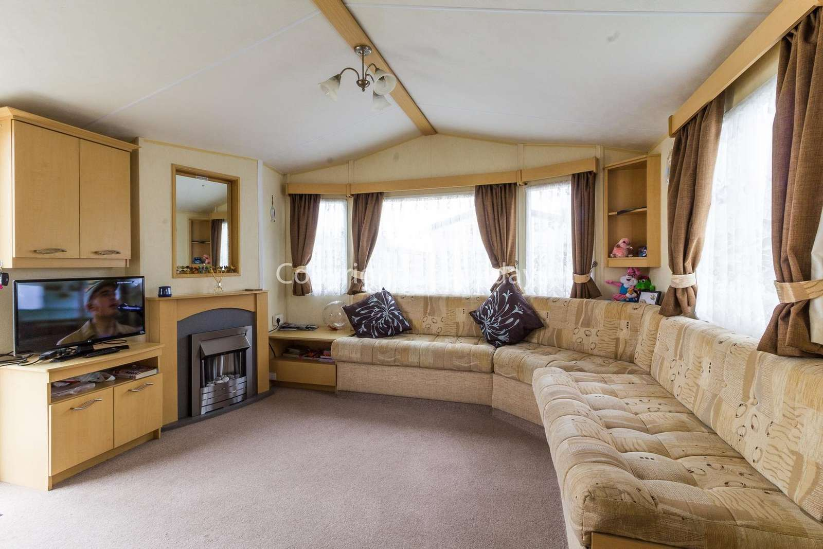 Spacious but homely lounge with an electric fire!