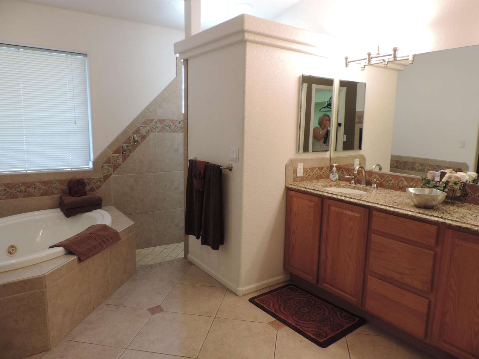 Full master bathroom has Jacuzzi tug and snail shower